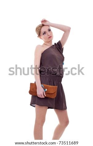 young beautiful adult girl wearing elegant dress and purse, thinking of something - stock photo