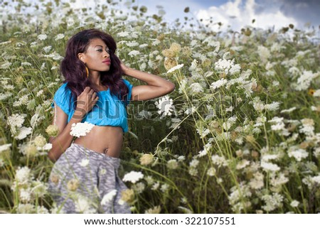 Young beautiful African American girl enjoys summer day. - stock photo