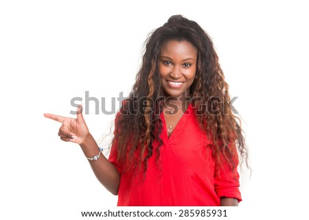 Young beautiful african woman presenting your product, isolated over white background - stock photo