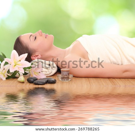 Young, beautiful and healthy woman getting spa treatment - stock photo