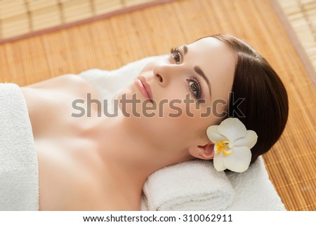 Young, beautiful and healthy woman in spa salon. Traditional oriental therapy and beauty treatments. - stock photo