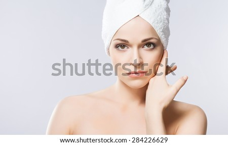 Young, beautiful and natural woman wrapped in towel  - stock photo