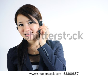 Young Beautiful and smiling call center operator with headset. Over white background