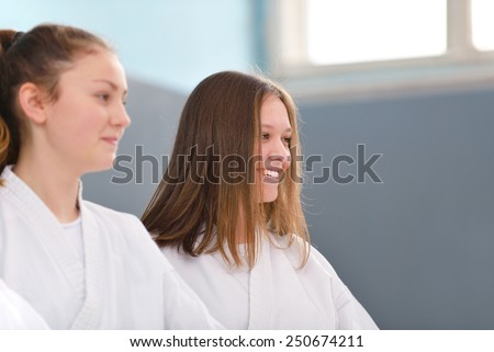 young, beautiful and successful woman karate, karate position - stock photo