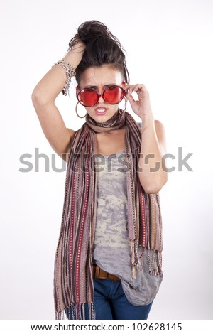 Young beautiful angry girl wearing funny red sunglasses.