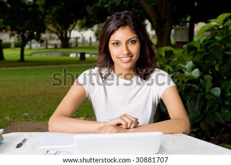 young beautiful Arabian college student in campus - stock photo