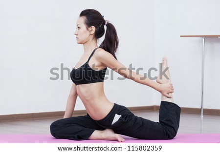 Young beautiful asian girl is professionally engaged in yoga