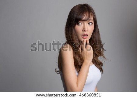 Young beautiful asian woman excited, panic, shocked emotion.