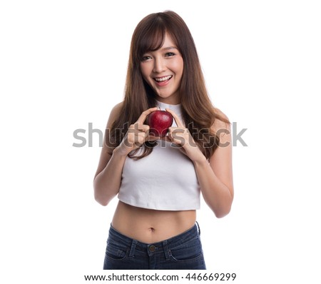 Young beautiful asian woman holding a red apple on white background