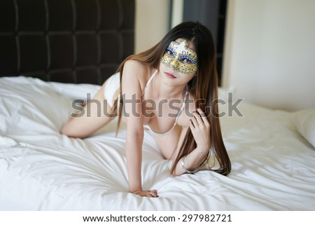 Young beautiful Asian woman in  bikini mask - stock photo