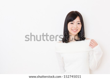 young beautiful asian woman on white background - stock photo