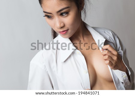 Young beautiful asian woman wearing men's shirt, topless. - stock photo
