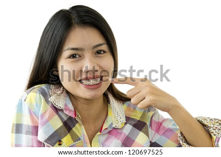 young beautiful asian woman with dental braces isolated on white background - stock photo