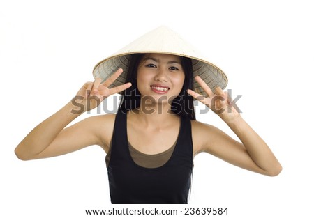 young, beautiful asian woman with hat making victory signs - stock photo