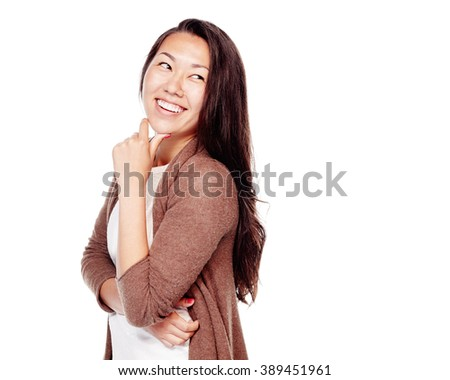 Young beautiful asian woman with long hair and perfect white teeth standing with hand on her chin, looking at side through shoulder and laughing isolated on white background - fun concept - stock photo