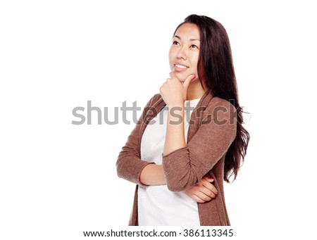 Young beautiful asian woman with long hair wearing brown cardigan, standing with hand on her chin, looking up and thinking isolated on white background - planning concept - stock photo