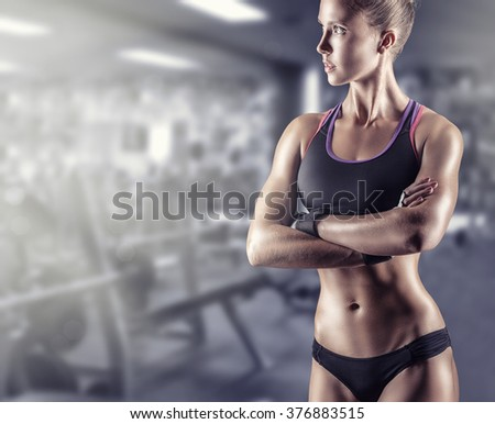 Young beautiful athlete woman in the gym - stock photo