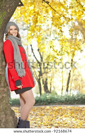 young beautiful autumn girl , fashion woman in red coat