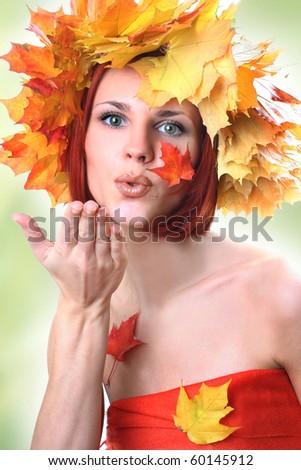 young beautiful autumn-girl on green - stock photo