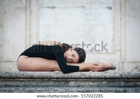 Young beautiful ballerina dancing on the Spanish Steps in Rome, Italy. Ballerina Project.  - stock photo