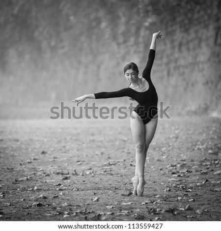 Young beautiful ballerina dancing out in Tevere riverside in Rome, Italy. Black and white image. Ballerina Project.