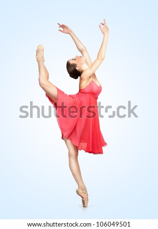 young beautiful ballerina on a gray background - stock photo