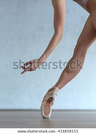 Young beautiful ballerina posing in ballet class