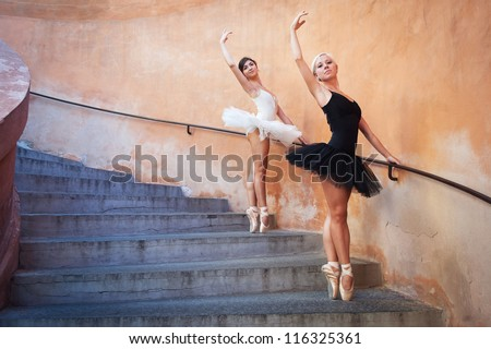 Young beautiful ballerinas dancing on the stairs. Ballerina project. - stock photo