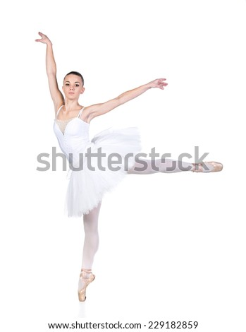 Young beautiful ballet dancer is posing on a studio background. - stock photo