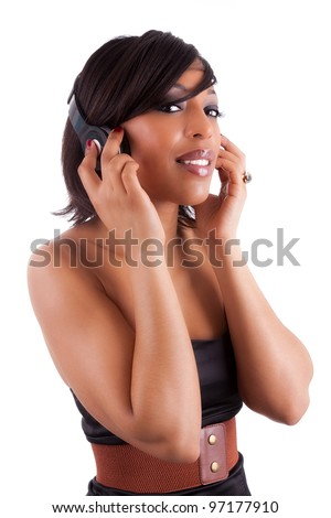 Young beautiful black woman in black dress listening to music, isolated on white background - stock photo