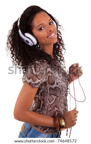 Young beautiful black woman listening to music