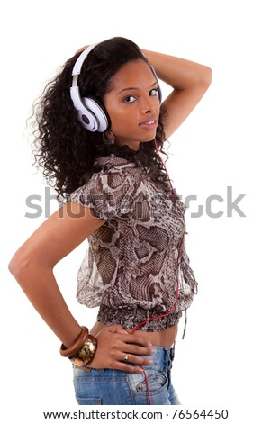 Young beautiful black woman listening to music - stock photo