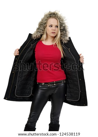 Young beautiful blond female opening her winter jacket to show the blank red t-shirt she is wearing. Ready for your design or artwork.