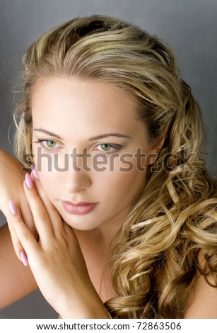 young beautiful blond female with long hair - stock photo