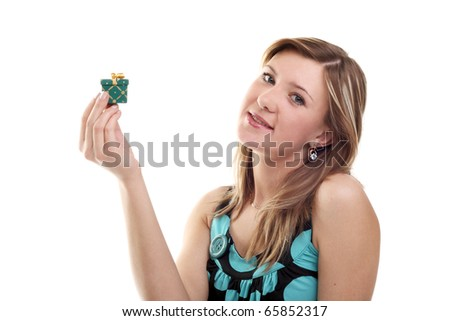 young beautiful blond girl with a little gift - stock photo