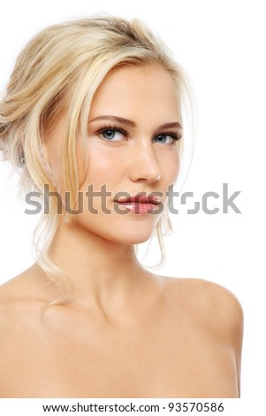 Young beautiful blond girl with clear make-up over white background