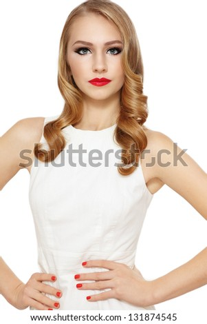 Young beautiful blond girl with long curly hair and red lipstick - stock photo