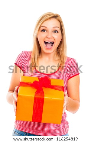 Young beautiful blond happy surprised woman holding orange gift box, isolated on white background. - stock photo