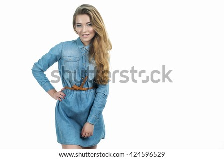 Young beautiful blond lady smiling in jeans dress. Studio portrait isolated on white of a young attractive hipster lady wearing jeans suit, fashion beauty summer portrait, cheerful chick, happiness - stock photo