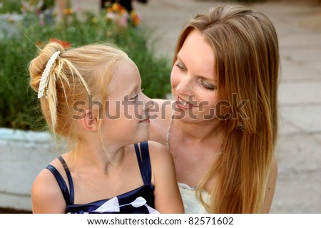 Young beautiful blond mother and daughter - stock photo