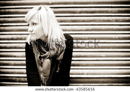 Young beautiful blond portrait on urban background. - stock photo
