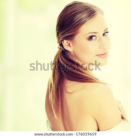 Young beautiful blond teen woman in bathrobe ready for spa - stock photo