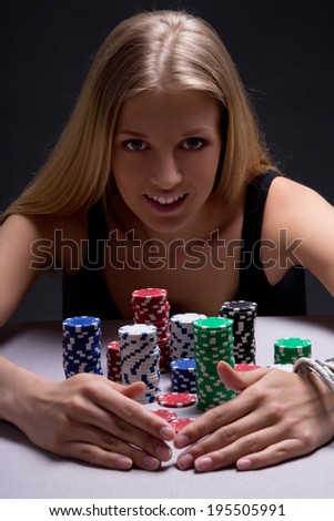 young beautiful blond woman with poker chips in casino