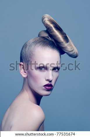 Young beautiful blond woman with styled hair - stock photo
