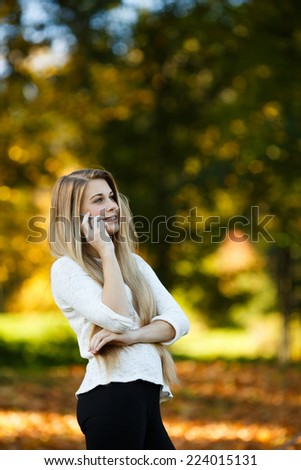 young beautiful blonde girl calling with mobile - stock photo