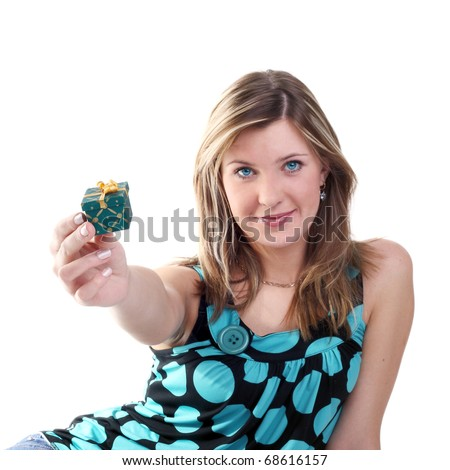 young beautiful blonde girl holding out the little gift - stock photo
