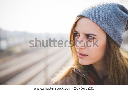 young beautiful blonde hipster woman in the city - stock photo