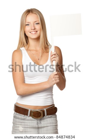 Young beautiful blonde holding blank white flag / board sign over white background - stock photo