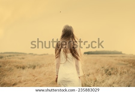 young beautiful blonde in the field - stock photo