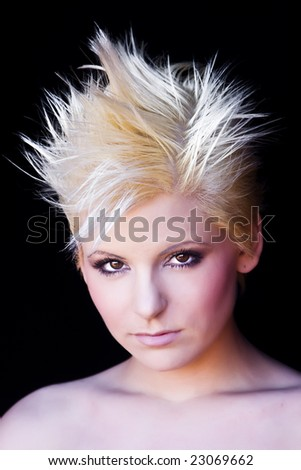 Young beautiful blonde isolated on black - stock photo